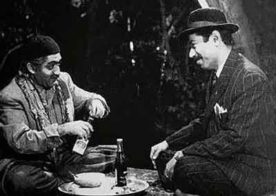 از راست: علی نصیریان، عزت الله انتظامی - فیلم آقای هالو ، کارگردان: داریوش مهرجویی